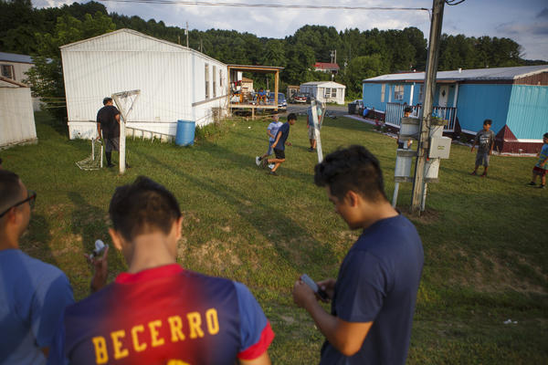 Children play soccer in the predominantly Hispanic trailer park off Hanes Road in Galax, Va. With a population of just around 7,000, the small town of Galax in rural southwest Virginia has one of the fastest-growing Hispanic populations in the state. Young adults who were born in Galax or arrived as children are now starting families of their own.