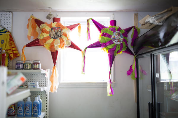 Piñatas hang in the window at the store that Fabiola Escamilla owns in Galax, Va.