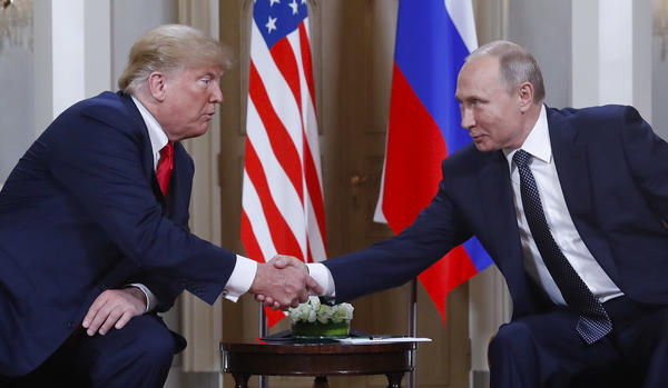 President Trump and Russian President Vladimir Putin shake hands at their summit in Helsinki, Finland, on Monday. Trump upset many in the U.S. intelligence community by refusing to endorse their finding that Russia interfered in the 2016 presidential election. Putin said he favored Trump in the election, but did not indicate whether he did anything to help him.