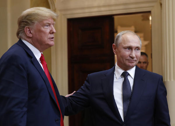 President Trump, left, and Russian President Vladimir Putin leave a press conference after their meeting Monday in Helsinki. Trump sided against his intelligence officials, who have said Russia interfered in the 2016 election.