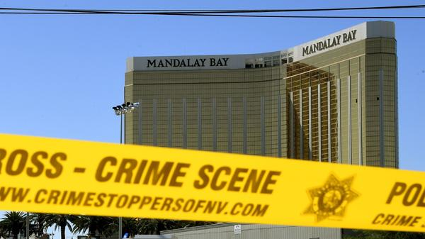 Crime scene tape surrounds the Mandalay Bay Resort and Casino in Las Vegas on Oct. 2, 2017. The broken windows show the room where a gunman sat as he opened fire on a country music festival, killing 58 people and wounding more than 500 others.