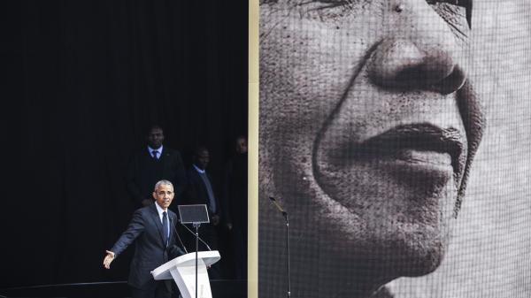 Former President Barack Obama speaks in Johannesburg on Tuesday at the centennial of Nelson Mandela's birth.