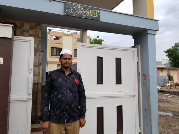 Shaikh Wasim Shaikh Karim, 32, rescued five people from an angry mob in front of his home earlier this month. He pulled the victims — a couple, their toddler and two relatives — to safety behind this gate, as the mob shattered his windows with stones.