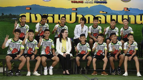 Twelve boys and their soccer coach, rescued from a flooded cave in northern Thailand, described their ordeal at a news conference in Chiang Rai on Wednesday, after they left the hospital.