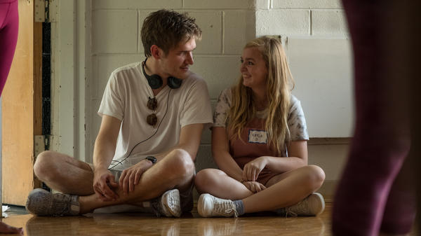 Writer and director Bo Burnham talks with Elsie Fisher on the set of <em>Eighth Grade. </em>Burnham says the anxiety he felt as a young performer helped him understand the social pressure teenage girls can experience.