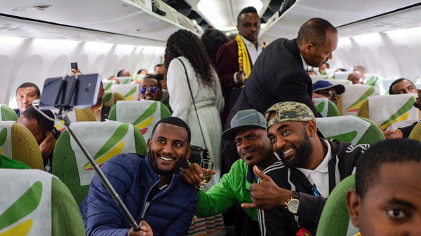 Passengers pose for a selfie picture inside an Ethiopian Airlines plane that departed from Bole International Airport in Addis Ababa, Ethiopia, and flew to Eritrea's capital, Asmara, on Wednesday. It was the first commercial flight between the two African countries in two decades.