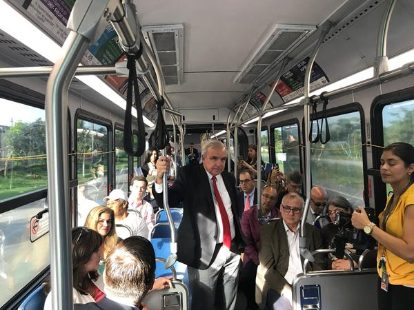 Miami-Dade County mayor Carlos Gimenez and other county officials rode a bus Tuesday morning to test a new system meant to speed up public and private transit.