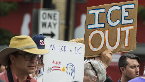People hold up signs July 16 in Washington, D.C., as they protest ICE. Getting rid of the agency has become a popular rallying cry among progressives, but the House on Wednesday overwhelmingly passed a symbolic measure voicing support for ICE.