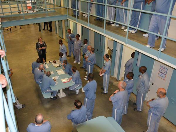 Department of Corrections Secretary Julie Jones speaks with prisoners at Wakulla Correctional Institute.