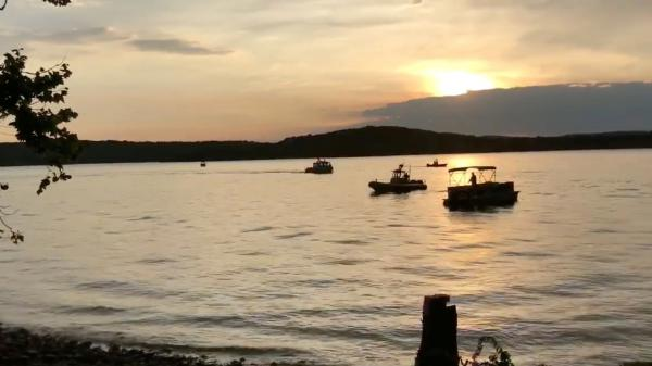 """Rescue personnel work after an amphibious """"duck boat"""" capsized and sank, at Table Rock Lake near Branson, Mo., on Thursday."""