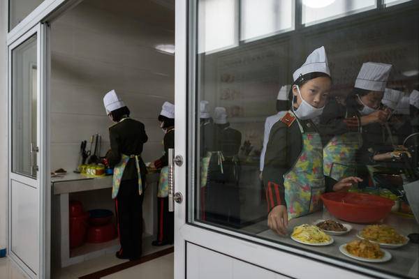 Female students participate in cooking lessons last month at the Kang Pan Sok military academy in Pyongyang. North Korea's business environment has been deeply destabilized by international sanctions, as evidenced by the report released Friday by the Bank of Korea.