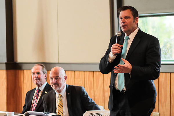 Secretary of State Kris Kobach with former state Sen. Jim Barnett (left) and Insurance Commissioner Ken Selzer (center) at a Republican candidate forum.