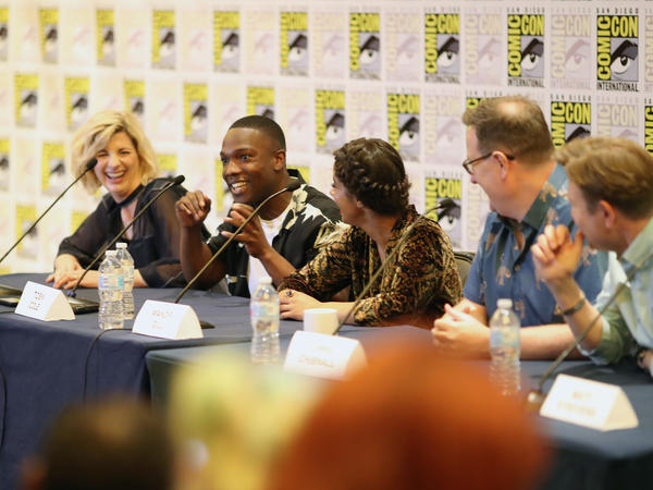 The new TARDIS crew — Jodie Whittaker and companions Tosin Cole and Mandip Gill, plus showrunner Chris Chibnall and executive producer Matt Strevens.