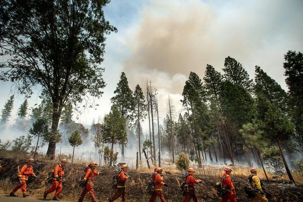 Firefighters battle the Ferguson fire on Sunday in Jerseydale, California.