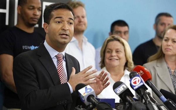 Rep. Carlos Curbelo, show here during a speech in downtown Miami in 2017, on Monday filed a bill that would tax energy companies for greenhouse gas emissions.