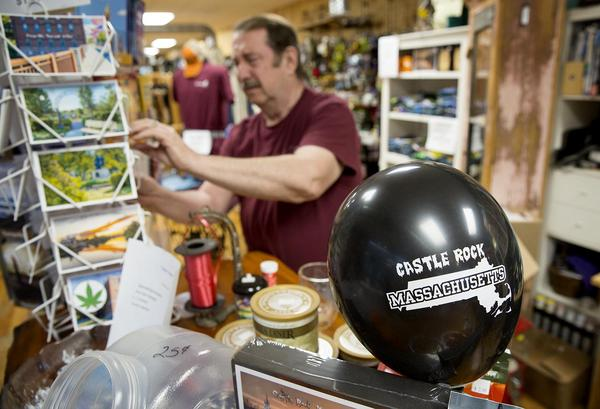 Castle Rock balloons and postcards are just two of the many Castle Rock items available in Paul Anderson's store in Orange. (Robin Lubbock/WBUR)