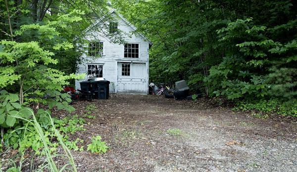"The ""Deaver House garage"" hidden in the woods above Orange, Mass. (Robin Lubbock/WBUR)"