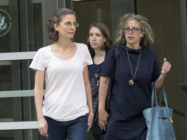 Clare Bronfman (left) leaves federal court in New York on Tuesday after being charged in connection with NXIVM. An heiress to the Seagram's liquor fortune, Bronfman was released on a $100 million bond.