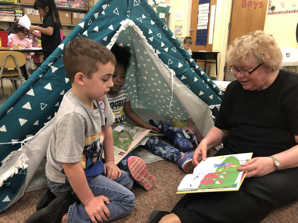 Pitcher Elementary Principal Karol Howard reads to students. Howard says working in small groups with students helps kids who are behind catch up.