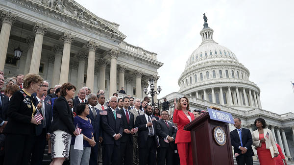 House Minority Leader Nancy Pelosi, D-Calif., is joined by House Democrats at a news conference in front of the U.S. Capitol on June 20 in Washington, D.C.