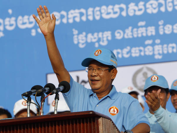 Cambodian Prime Minister Hun Sen waves to supporters in Phnom Penh on Friday. Ahead of Sunday's elections, Hun Sen's ruling party has banned the main opposition party, jailed its leaders and other critics and shut independent media outlets. Opposition politicians in exile are urging a boycott.