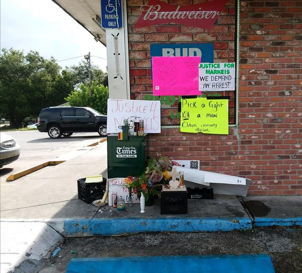 A memorial has been set up outside the convenience store where Markeis McGlockton was shot and killed last week.
