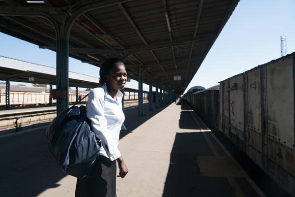 """Sidumiso Nyoni, 30, took the train from her home in rural Nyamandhlovu, Zimbabwe, to the industrial city of Bulawayo to visit family. """"The train doesn't have a specific time at which it comes,"""" she says."""
