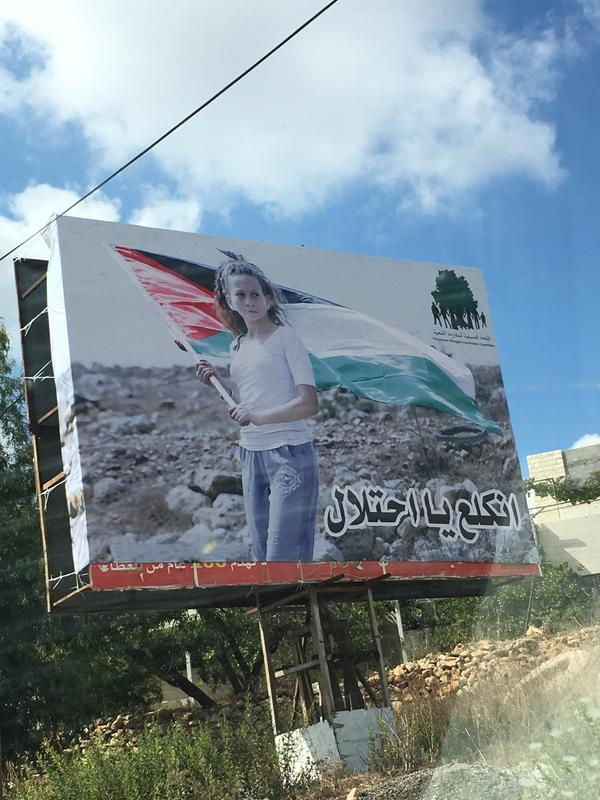 "Tamimi has become an icon for many Palestinians. A billboard in Nabi Saleh shows her photo with the words ""Go away occupation."""