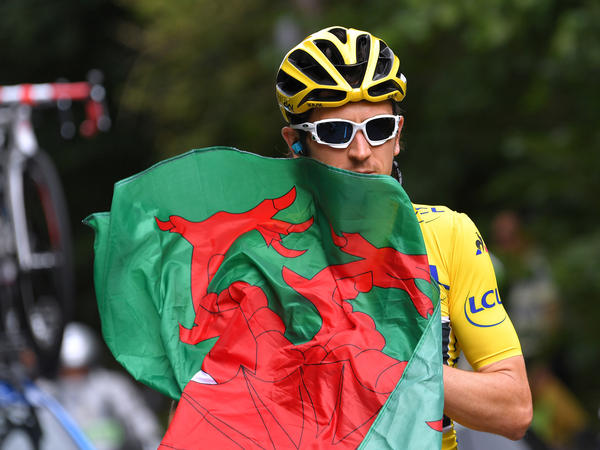 Geraint Thomas of Great Britain carries the flag of Wales during the 105th Tour de France 2018, Stage 21 stage from Houilles to Paris on Sunday.