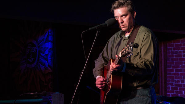 David Dondero performs at D.G.'s Tap House in Ames, Iowa.