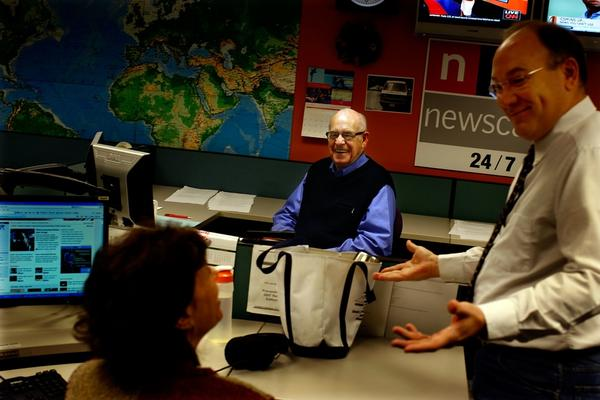 On Dec. 29, Kasell discusses a newscast with senior producer Dave Pignanelli (right) and fellow newscaster Barbara Klein. Kasell regularly arrived at work at 2 a.m.