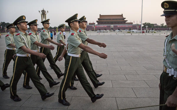 Chinese paramilitary officers march in Tiananmen Square on Tuesday in Beijing. The government has launched an unprecedented effort to suppress any public, or private, commemoration of June 4, 1989.