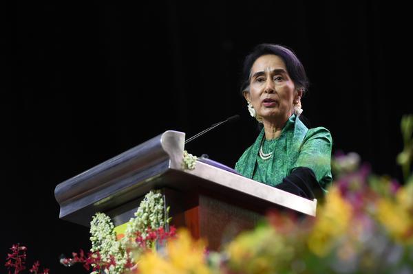Nobel laureate Aung San Suu Kyi (shown here in December 2016) faces international pressure to address the Rohingya crisis.