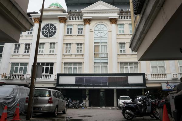 The front of the Hizb ut-Tahrir headquarters in Jakarta has a blacked-out sign. The Islamic organization favors a global caliphate and was banned in July by the government, which deemed it a threat to national unity.
