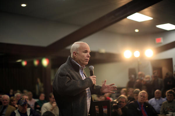 As a Republican presidential hopeful in 2007, McCain speaks during a town hall meeting in Des Moines, Iowa. He won the nomination that year and garnered nearly 60 million votes on Election Day, a sign of his resilience.