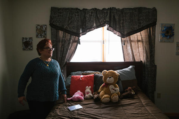 Pauline stands in her room after coming home from a day program for adults with intellectual disabilities.