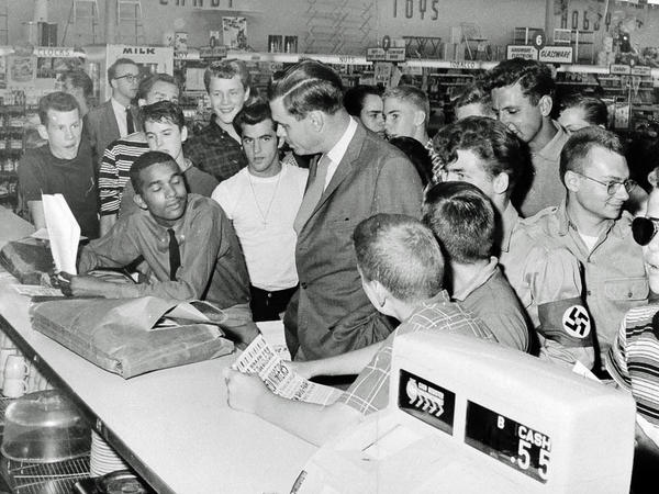 """Dion Diamond listens with his eyes closed to George Lincoln Rockwell, the founder of the American Nazi Party, at a """"whites-only"""" lunch counter in Arlington, Va., in 1960."""