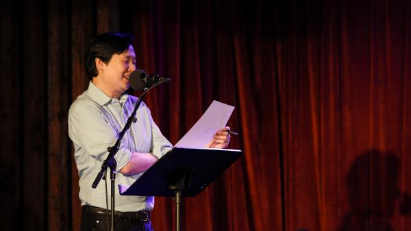 Puzzle Guru Art Chung leads the final round on Ask Me Another at the Bell House in Brooklyn, New York.