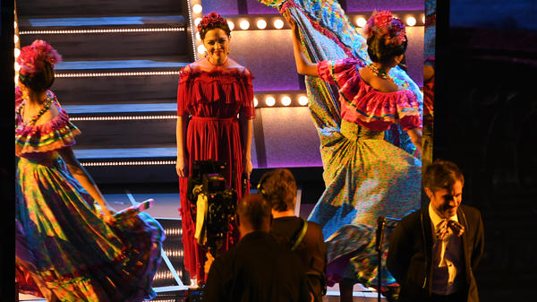 Singer Natalia Lafourcade (second from left, in red) and actor Gael Garcia Bernal (bottom right) onstage during the 90th Annual Academy Awards.