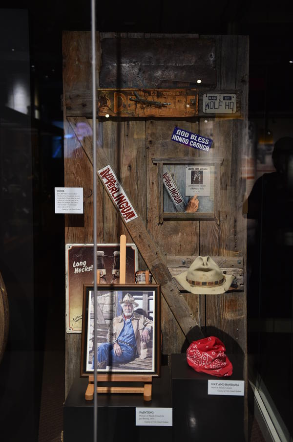 "The door from a general store in Luckenbach, Texas, which was photographed for Jerry Jeff Walker's album <em>¡Viva Terlingua!</em>, at the ""Outlaws and Armadillos"" exhibition."