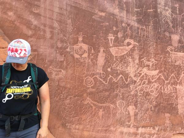 Rock art created as much as 5,000 years ago covers maroon cliffs bordering the Escalante River.
