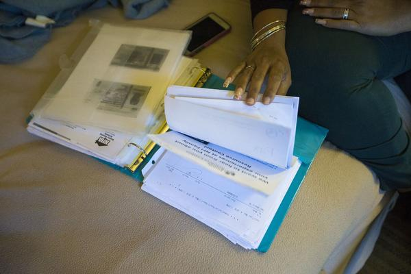 Lisbeth Sandoval keeps records of all of the housing applications she has submitted since relocating from Puerto Rico in January. (Jesse Costa/WBUR)