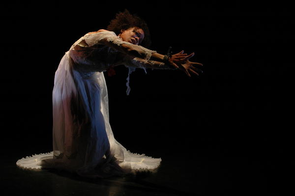 "Gesel Mason performs David Roussève's ""Jumping the Broom"" as part of her performance project <em>No Boundaries: Dancing the Visions of Contemporary Black Choreographers.</em>"