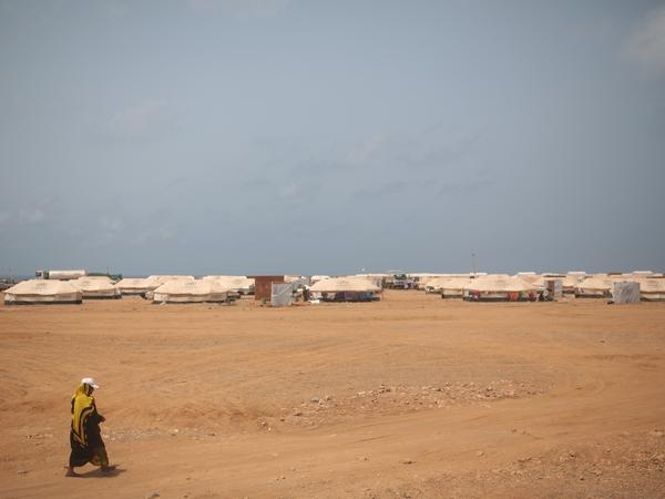 A Yemeni refugee walks to a refugee camp in the small African country of Djibouti. Thousands of Yemenis have come to Djibouti, fleeing their country's civil war. Many of them are trying to get visas to come to the United States. But President Trump's travel ban includes Yemen, which means only Yemenis who obtain a special waiver can come.