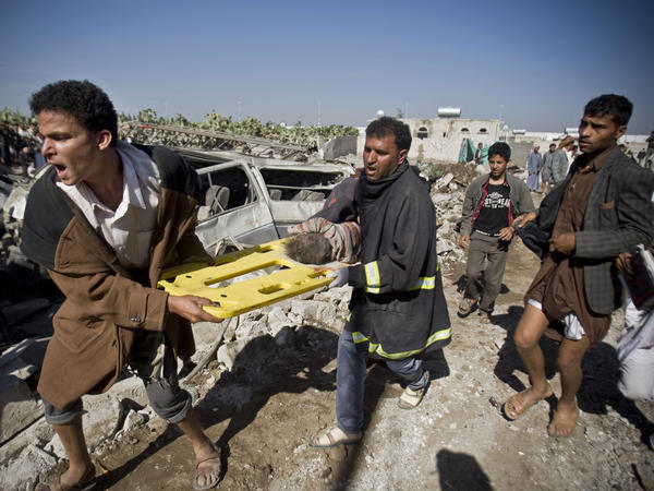 After Saudi airstrikes in Sanaa, Yemen in 2015, people carry the body of a child uncovered from under the rubble. The United Nations has declared Yemen the world's worst humanitarian crisis. When Yemen's war began, Nageeb Alomari decided to bring his wife and daughters to the U.S.