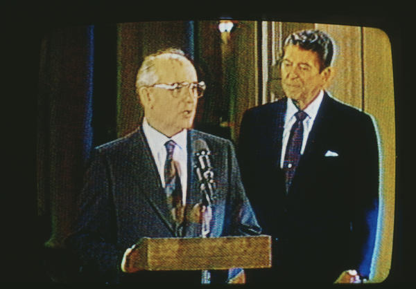 Mikhail Gorbachev and President Ronald Reagan on television December 8, 1987. They met in Washington to sign a treaty that banned intermediate-range nuclear missiles.