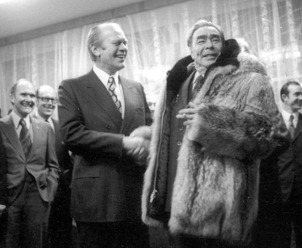 President Gerald Ford shakes hands with Leonid Brezhnev in 1974 after the Soviet leader tried on Ford's fur coat at a summit in the eastern Soviet city of Vladivostok.
