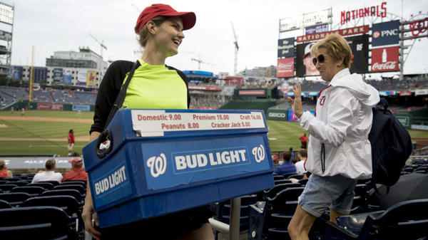 Nationals Park beer seller Christy Colt talks to a customer in the stands before a recent Nationals  game.
