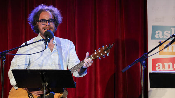One-man house band Jonathan Coulton leads a music parody game on Ask Me Another at the Bell House in Brooklyn, New York.