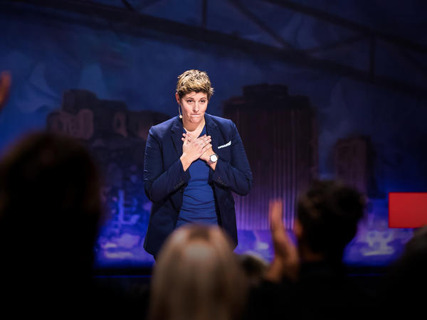 Sally Kohn on the TED stage.